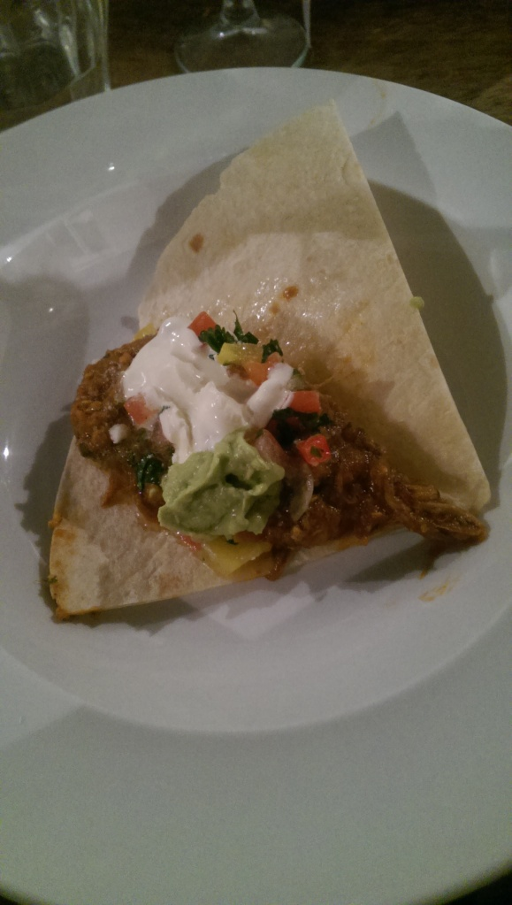Dish 6: Mexico - taco with guacamole and sour cream.