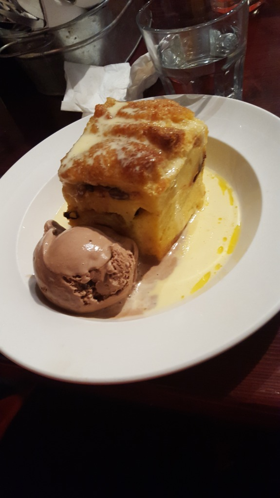 Bread and butter pudding with crème anglaise and ice cream