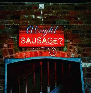 Alright Sausage neon sign at the Riverside, Sheffield